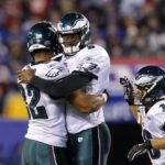 Eagles' Young celebrates his touchdown pass with Harbor during their NFL football game against the Giants in East Rutherford