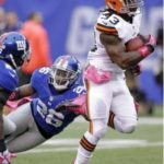 Cleveland running back Trent Richardson breaks through New York tacklers as he rushes for a first-quarter touchdown.